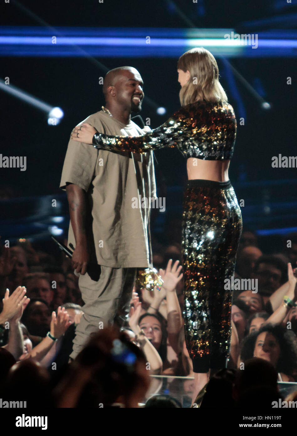 Rapper Kanye West and Taylor Swift hug at the MTV Video Music Awards on August 30, 2015 in Los Angeles. Photo by - Stock Image