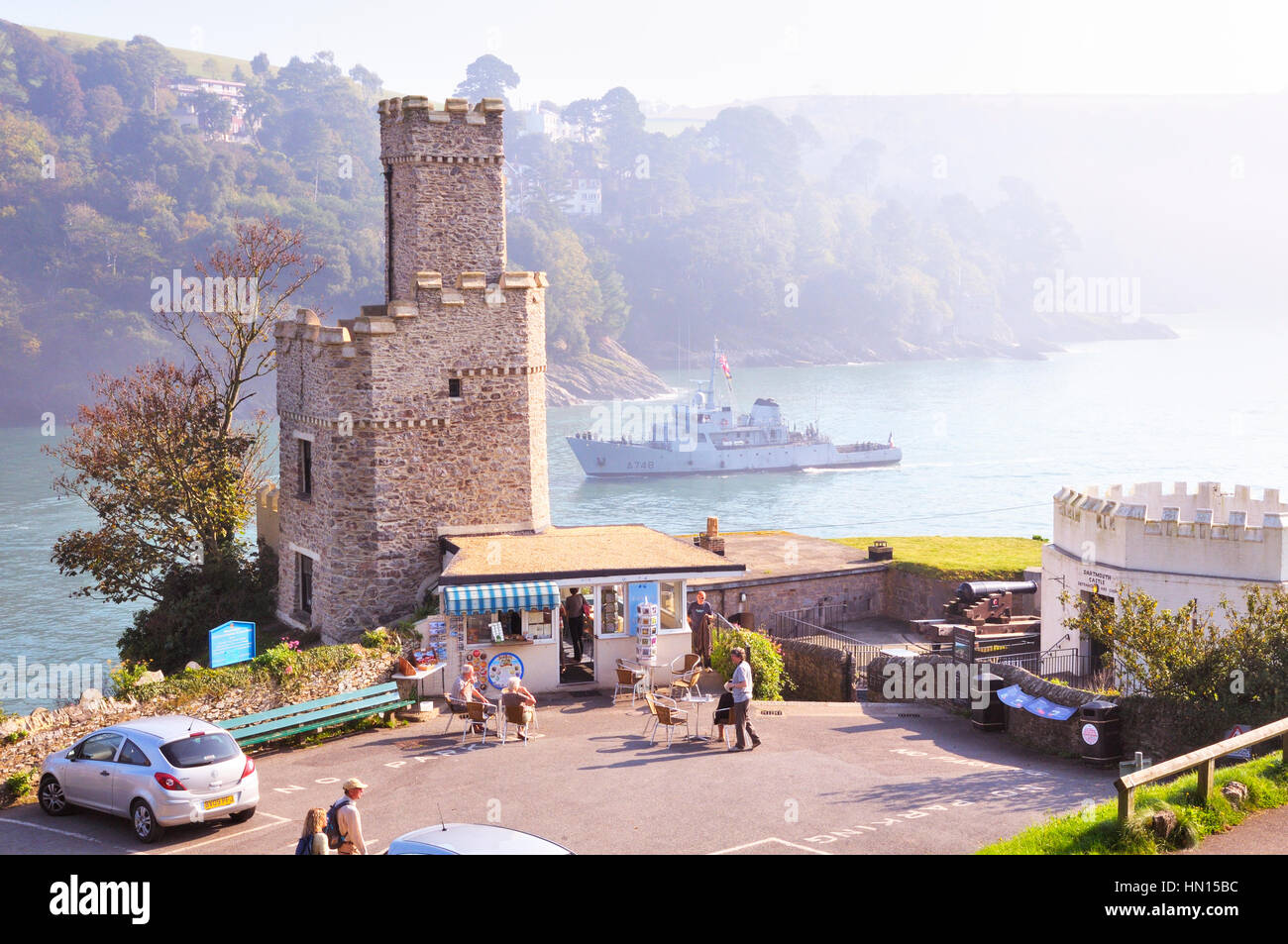 Dartmouth Castle and Tea Rooms with a passing naval ship on the River Dart estuary, South Hams, Devon, England, - Stock Image