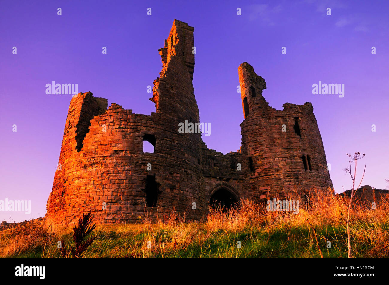 Dunstanburgh Castle, Northumberland, England, UK - Stock Image