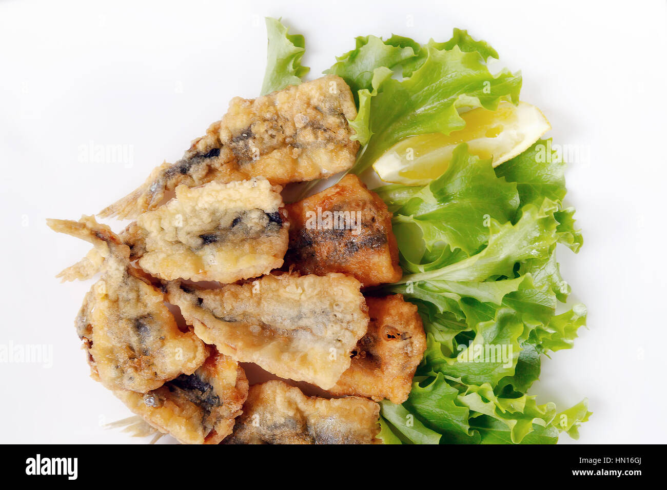 Typical dish of Neapolitan cuisine in Italy. Anchovies breaded in flour, then egg, fried in peanut oil. Ready meal - Stock Image