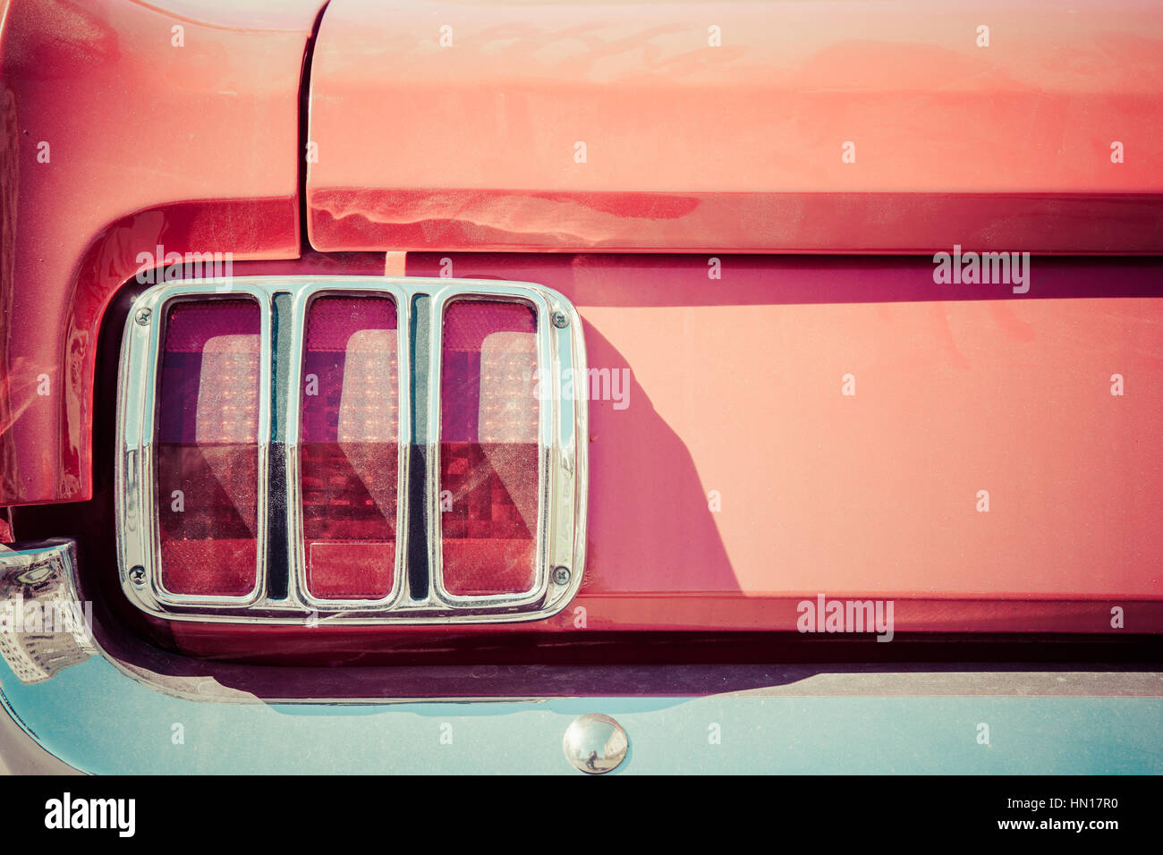 Color and beauty of vintage cars. Details of a red boot, red tail ...