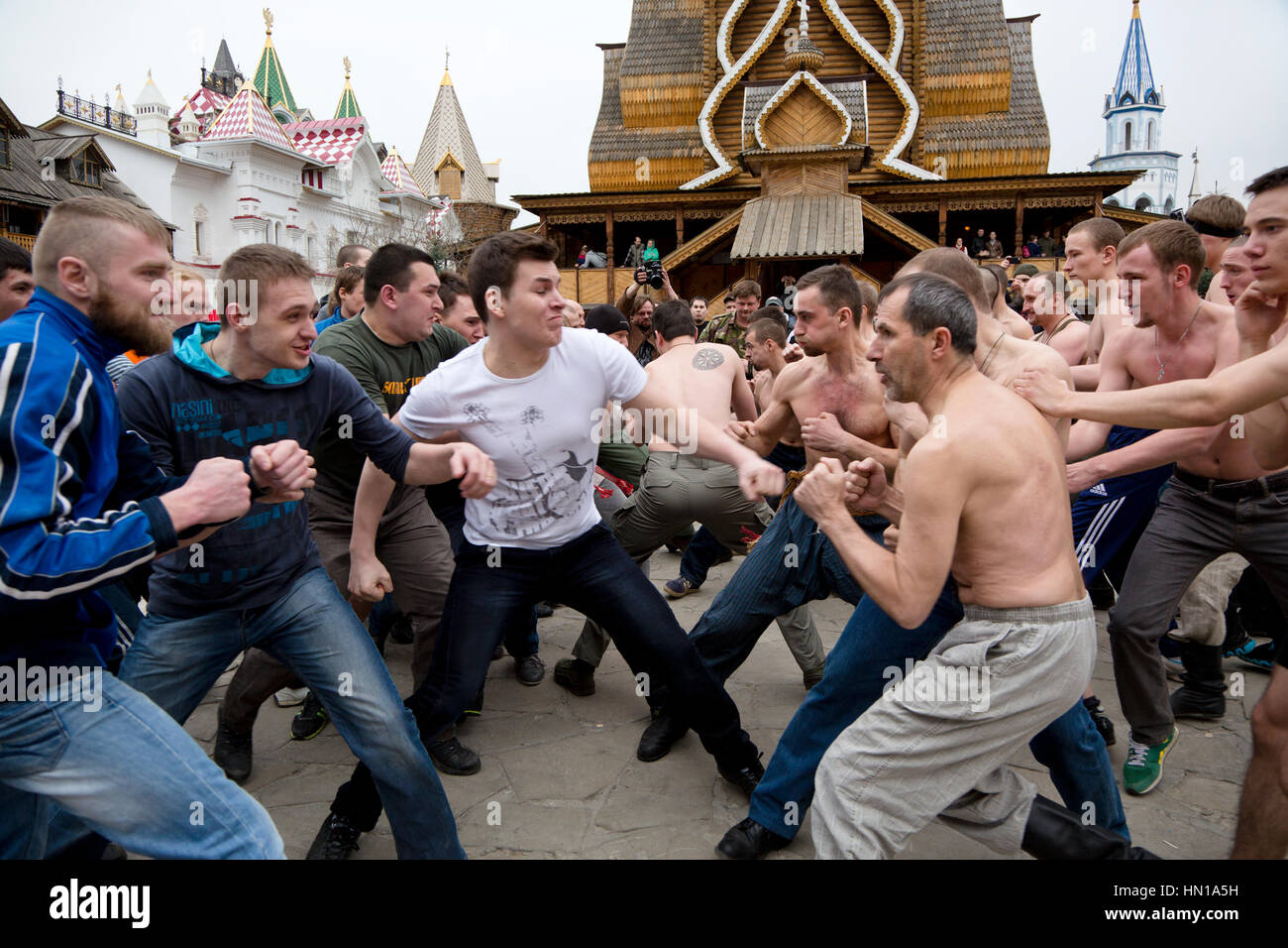 Guests engage in traditional line fighting at the Maslenitsa Festival on the territory of the Izmailovo Kremlin - Stock Image