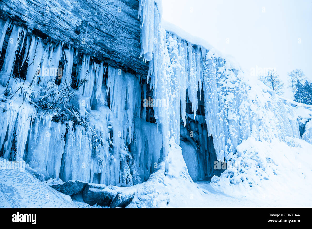Ice cave in frozen waterfall Jagala, Estonia - Stock Image