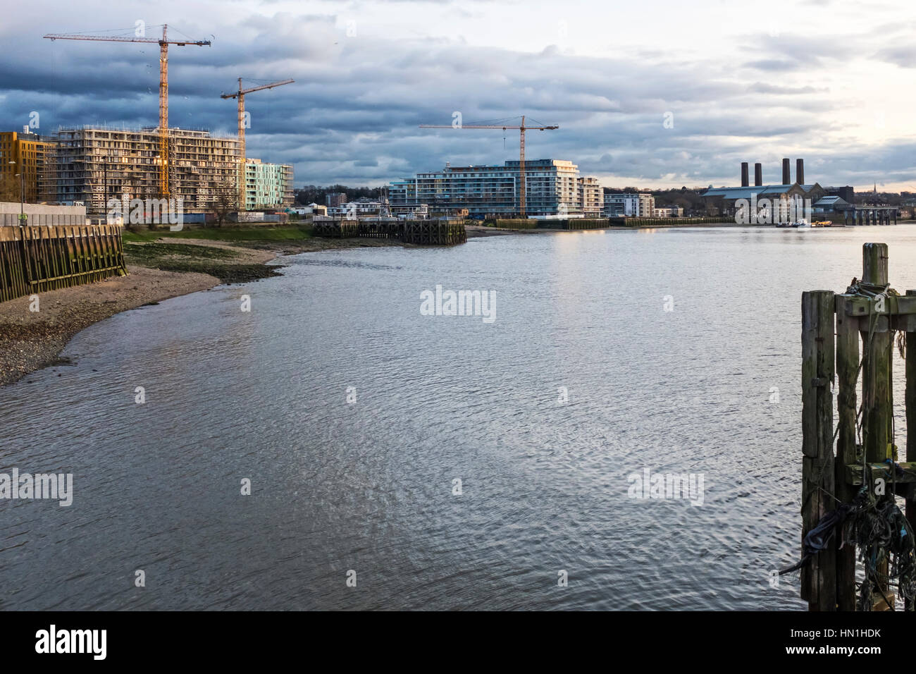 New Build apartments and construction sites of luxury apartment blocks, next to Thames river, Greenwich, London - Stock Image