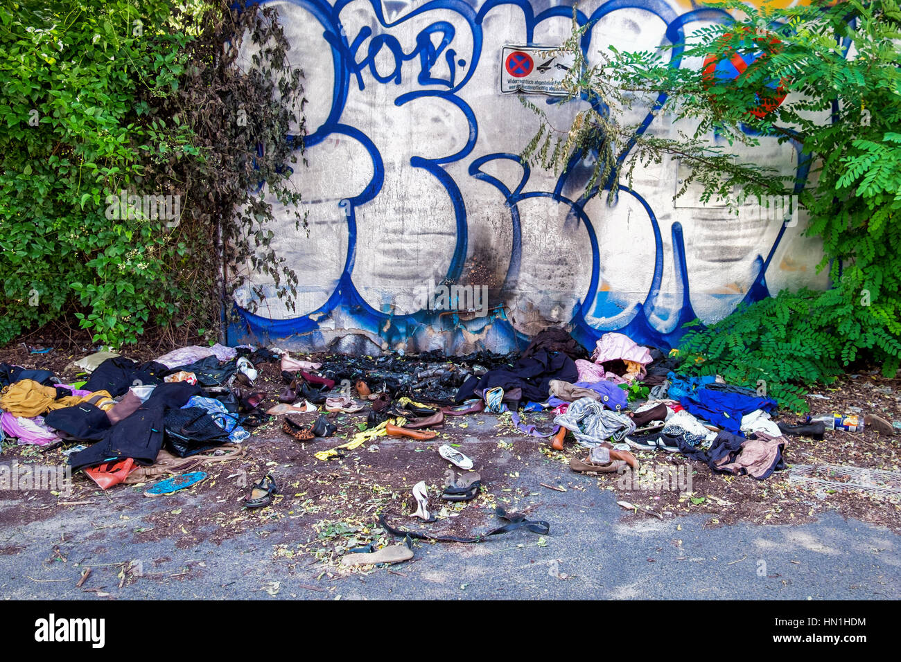 Berlin Vandalism, Clothing collected for the homeless set alight and destroyed - Stock Image