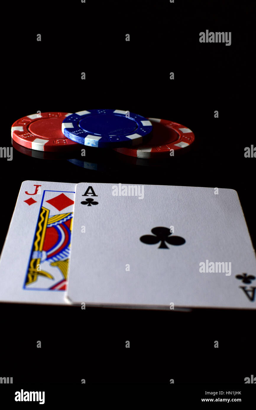 Blackjack. Playing cards ace and jack and betting chips on the table. - Stock Image