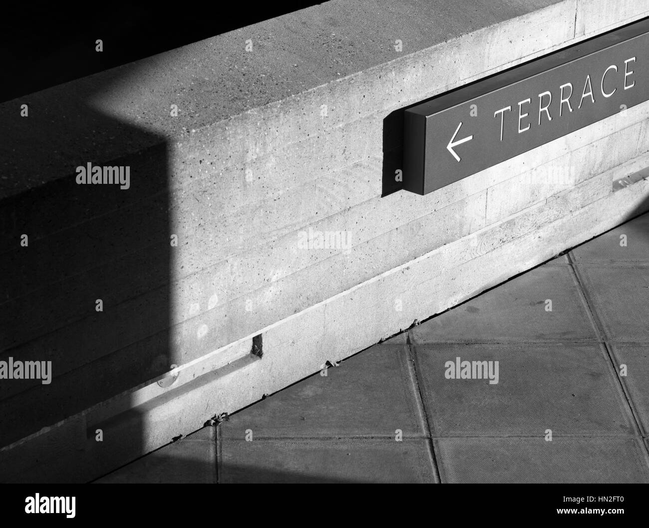 Sign pointing to a terrace, London, UK - Stock Image