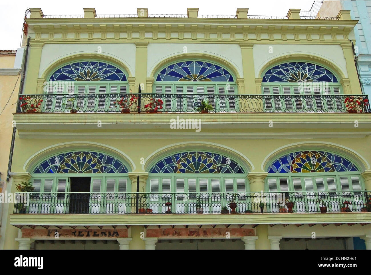 View of the Two Upper Levels of Enclosed Loggias of Casa de Manuel Antuve in Plaza Vieja, Old Havana, Cuba - Stock Image