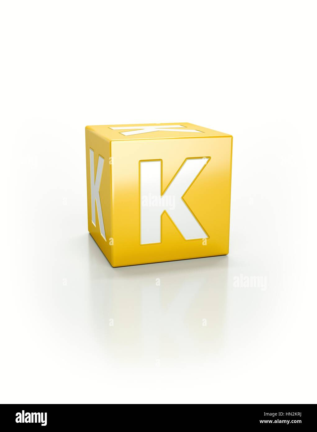 Yellow cube with letter K. - Stock Image