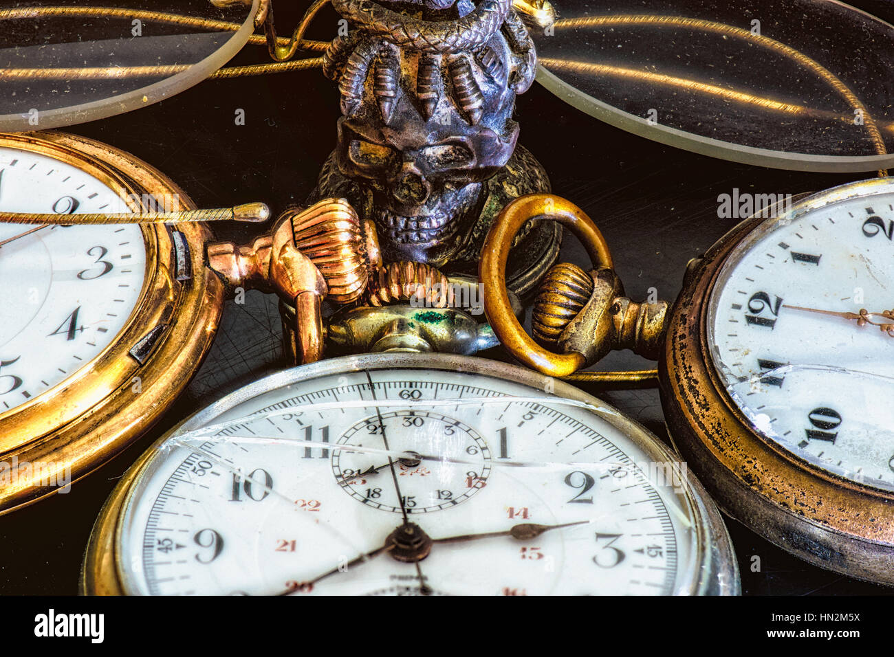 Vintage Still Life with old golden pocket watches , glasses and stamp seal in colour - Stock Image
