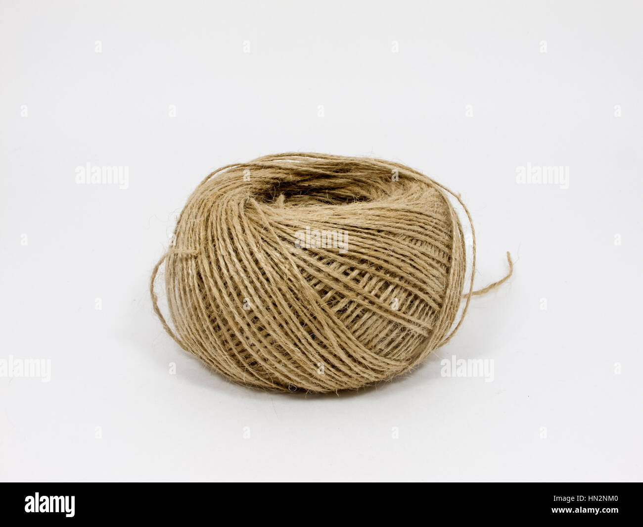 Skein of jute twine isolated on the white background - Stock Image
