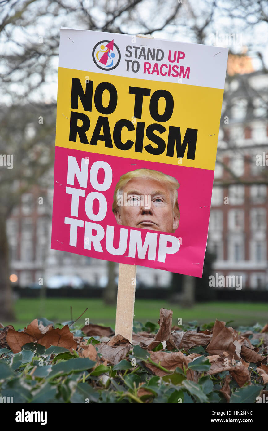 No To Racism Placard,Ant-Trump Demonstration outside of The U.S Embassy,Grosvenor Square,London UK - Stock Image