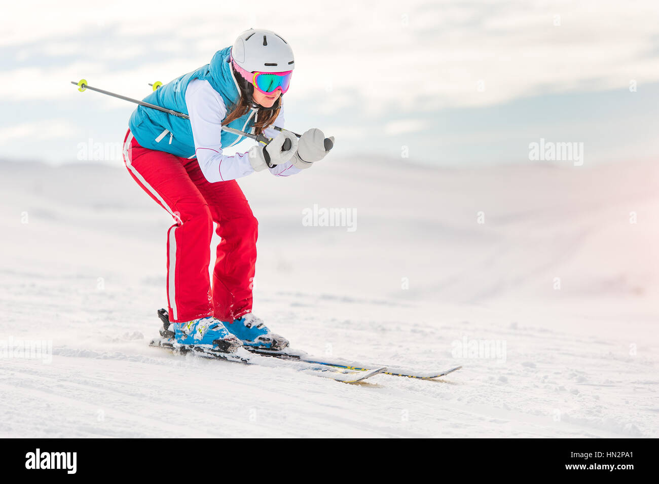 Girl woman skier in downhill position - Stock Image