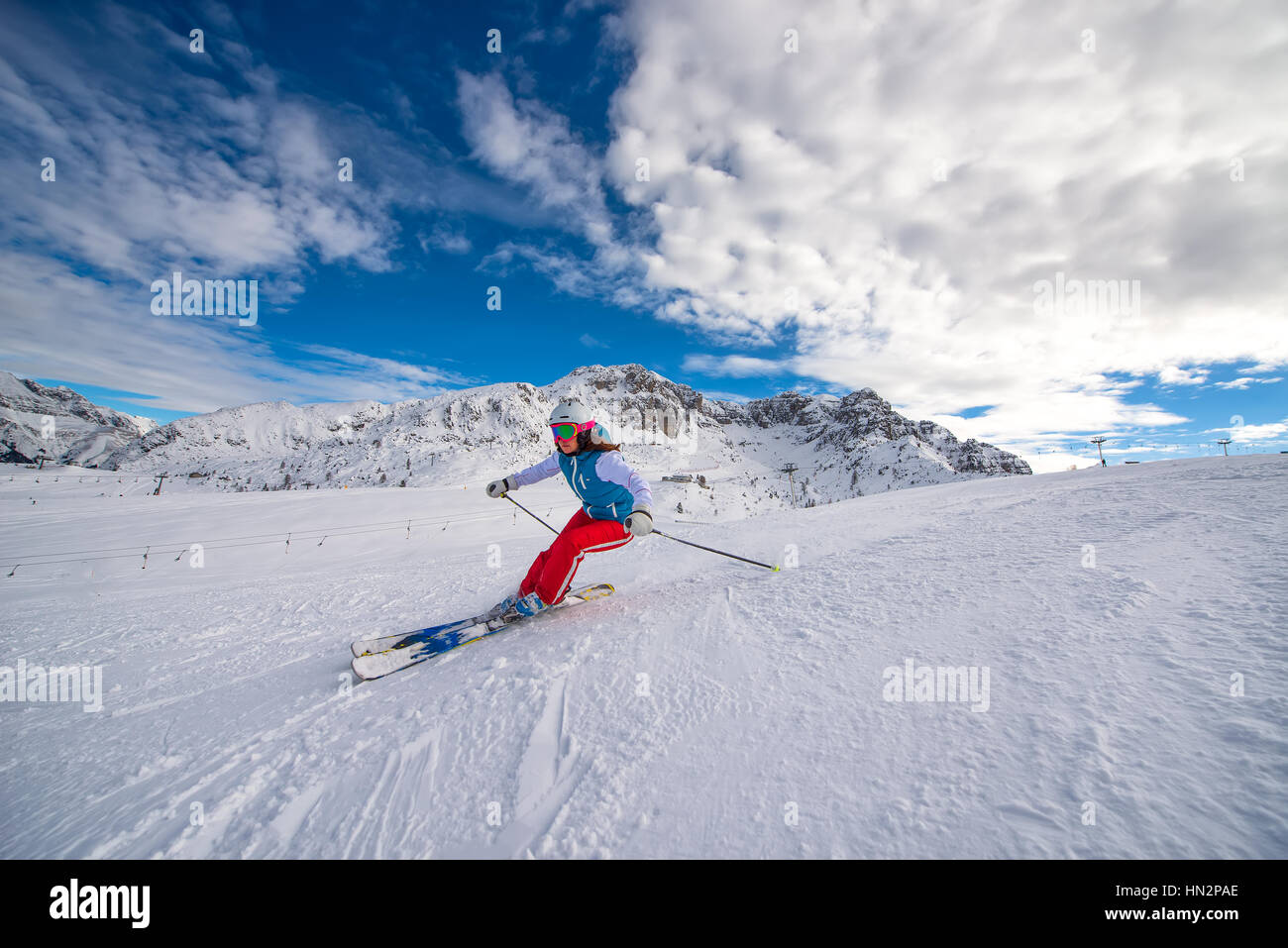 Girl skier in the alps ski area - Stock Image