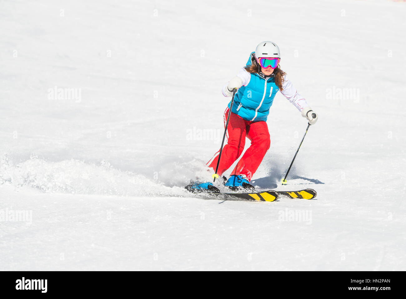 Girl skier with good technique while ago slalom curves - Stock Image