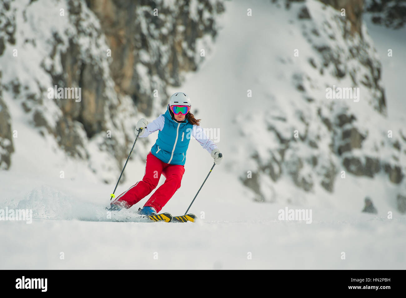 Young woman skier ago slalom - Stock Image