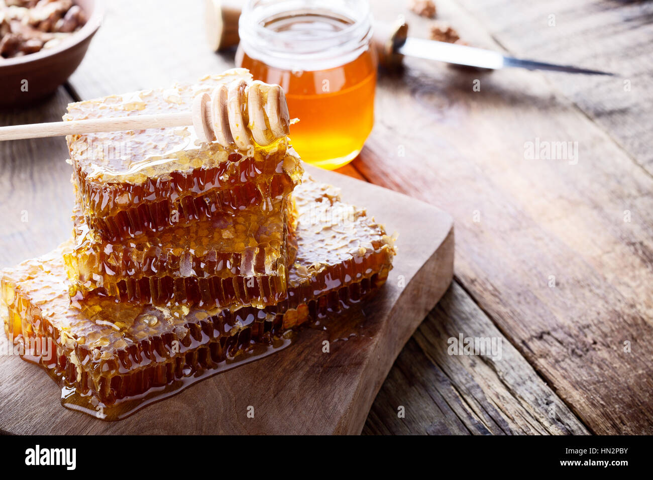 Organic  raw honeycombs on wooden board, pure natural sweet goodness - Stock Image