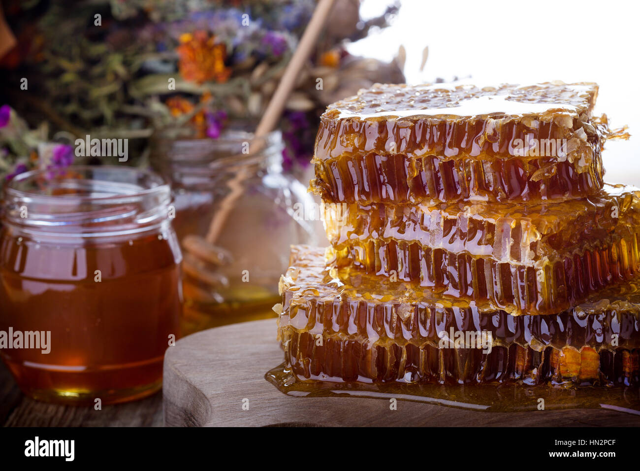 Organic  raw honeycombs on wooden board, flower honey on savior of the honey feast day. Eastern slavic folk holiday, - Stock Image