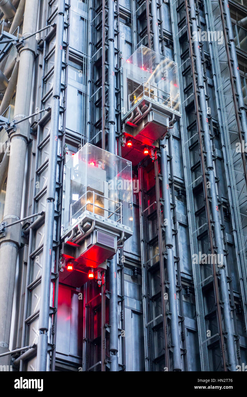 Two lifts on the outside of the Lloyds building, City of London, UK Stock Photo