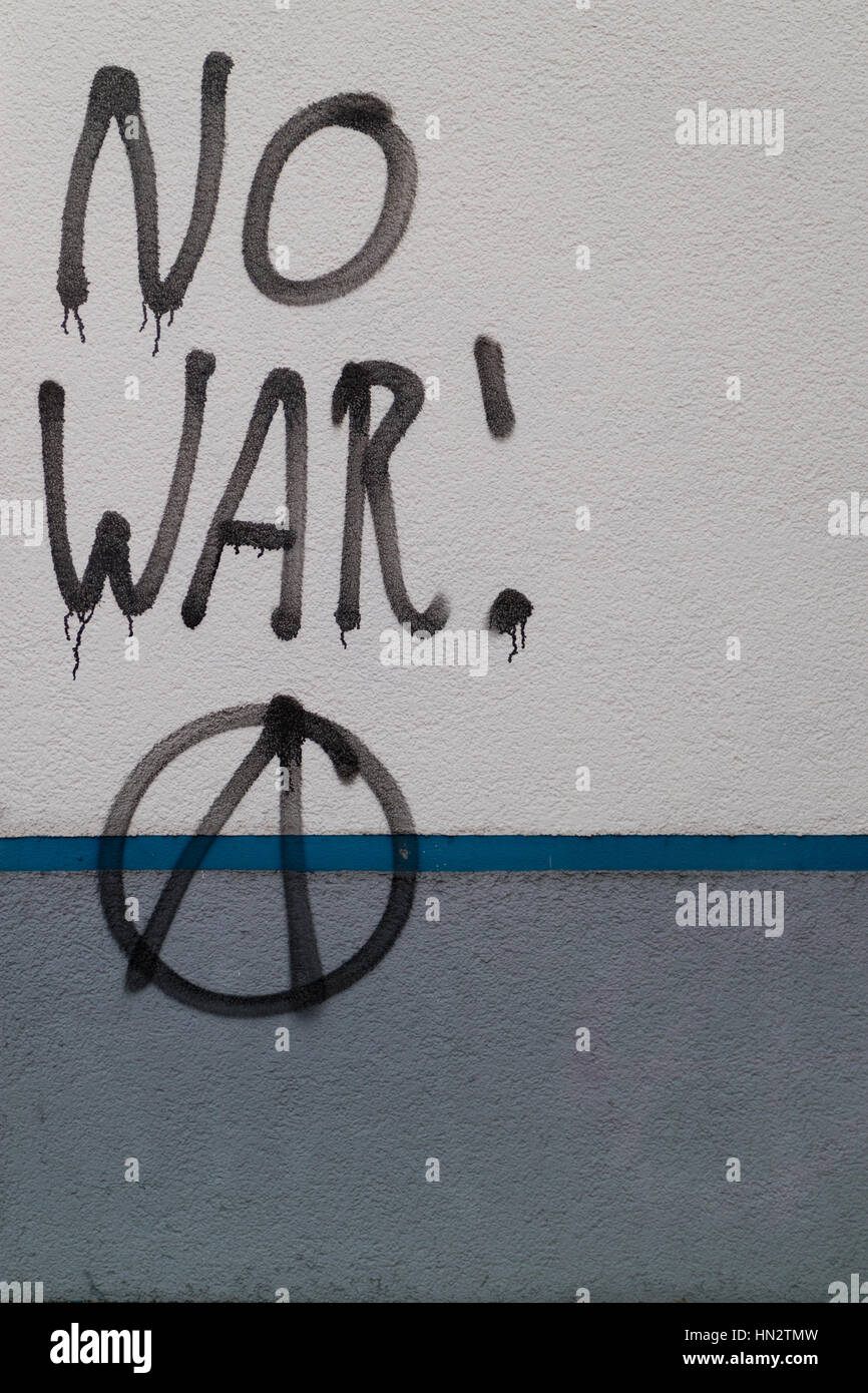 Graffiti on a building says No War, with anarchy symbol - Stock Image