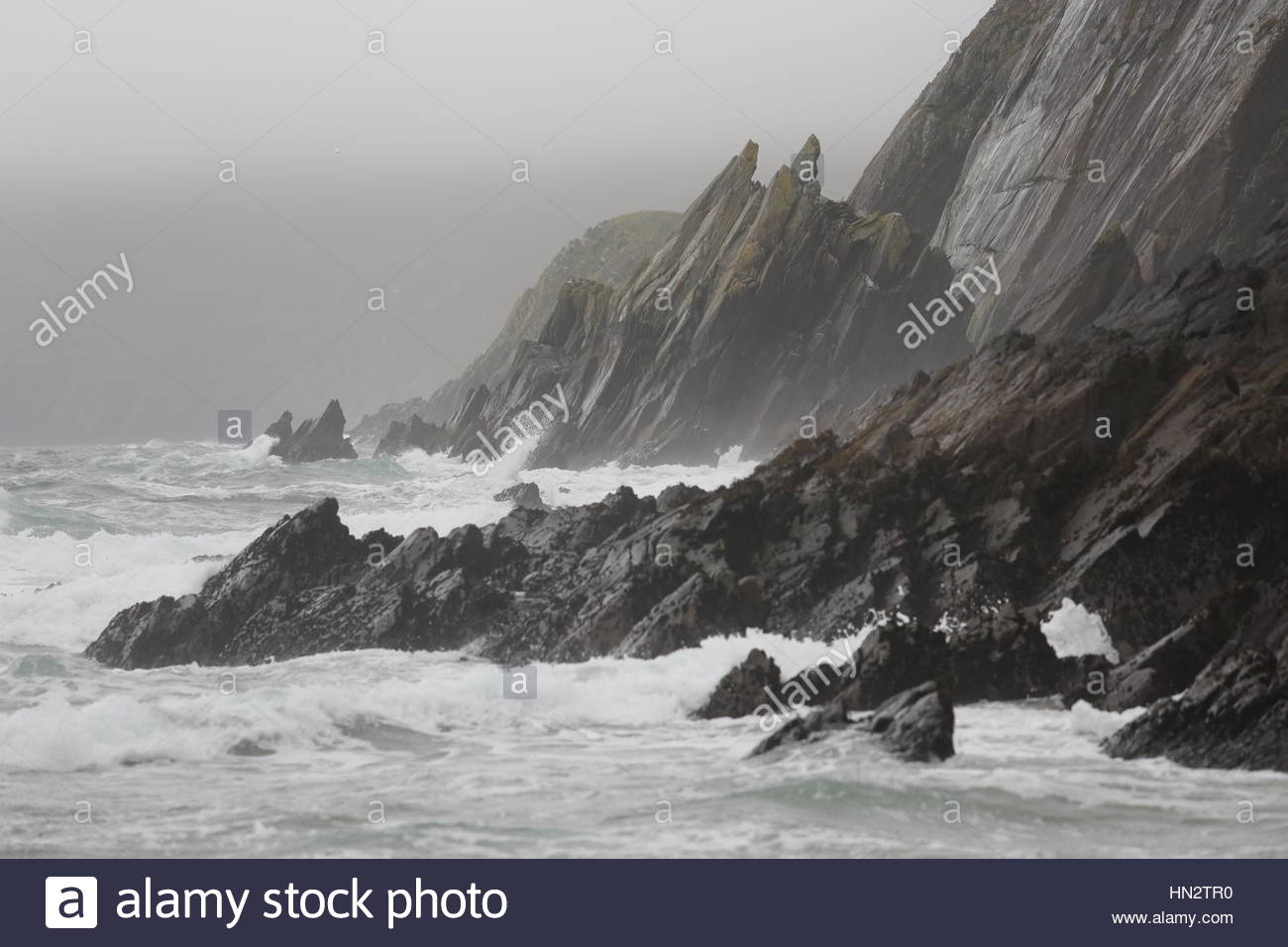 Ireland in all its beauty as the Atlantic Ocean waves crash on rocks near the Great Blasket Island off the coast - Stock Image