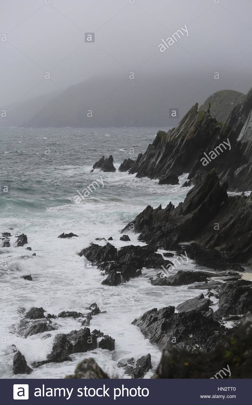 Ireland in all its beauty:Ireland in all its beauty as the Atlantic Ocean waves crash on rocks near the Great Blasket - Stock Image
