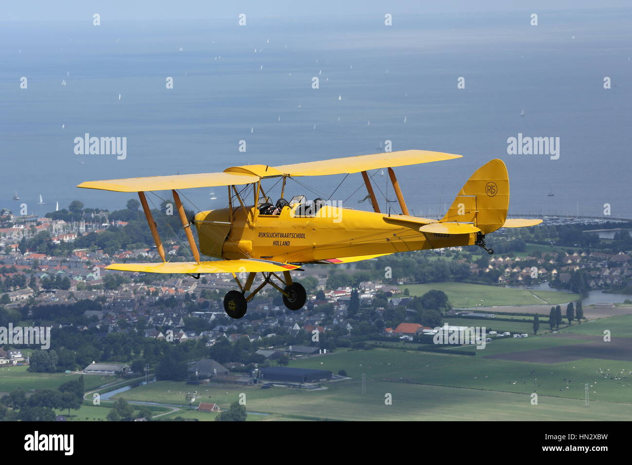 An air to air photo of a vintage Tiger Moth bi-plane - Stock Image