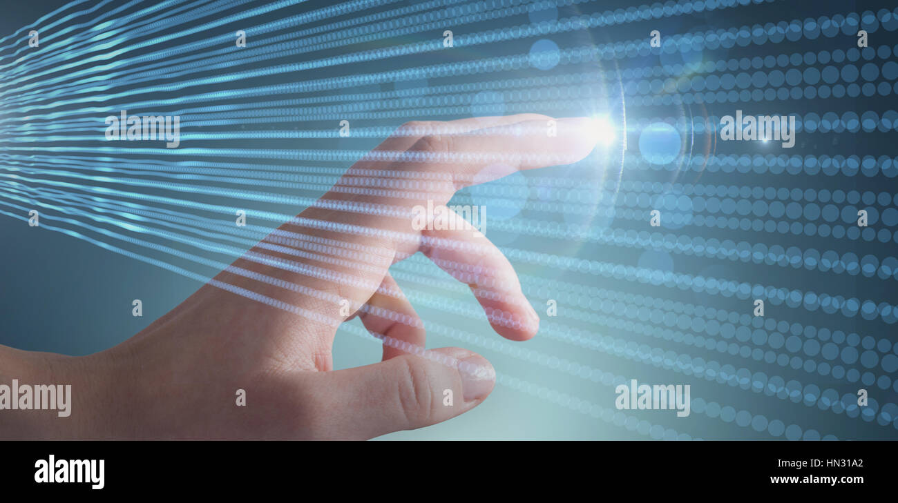 Cropped hand of woman against blue abstract shiny lines on black background - Stock Image