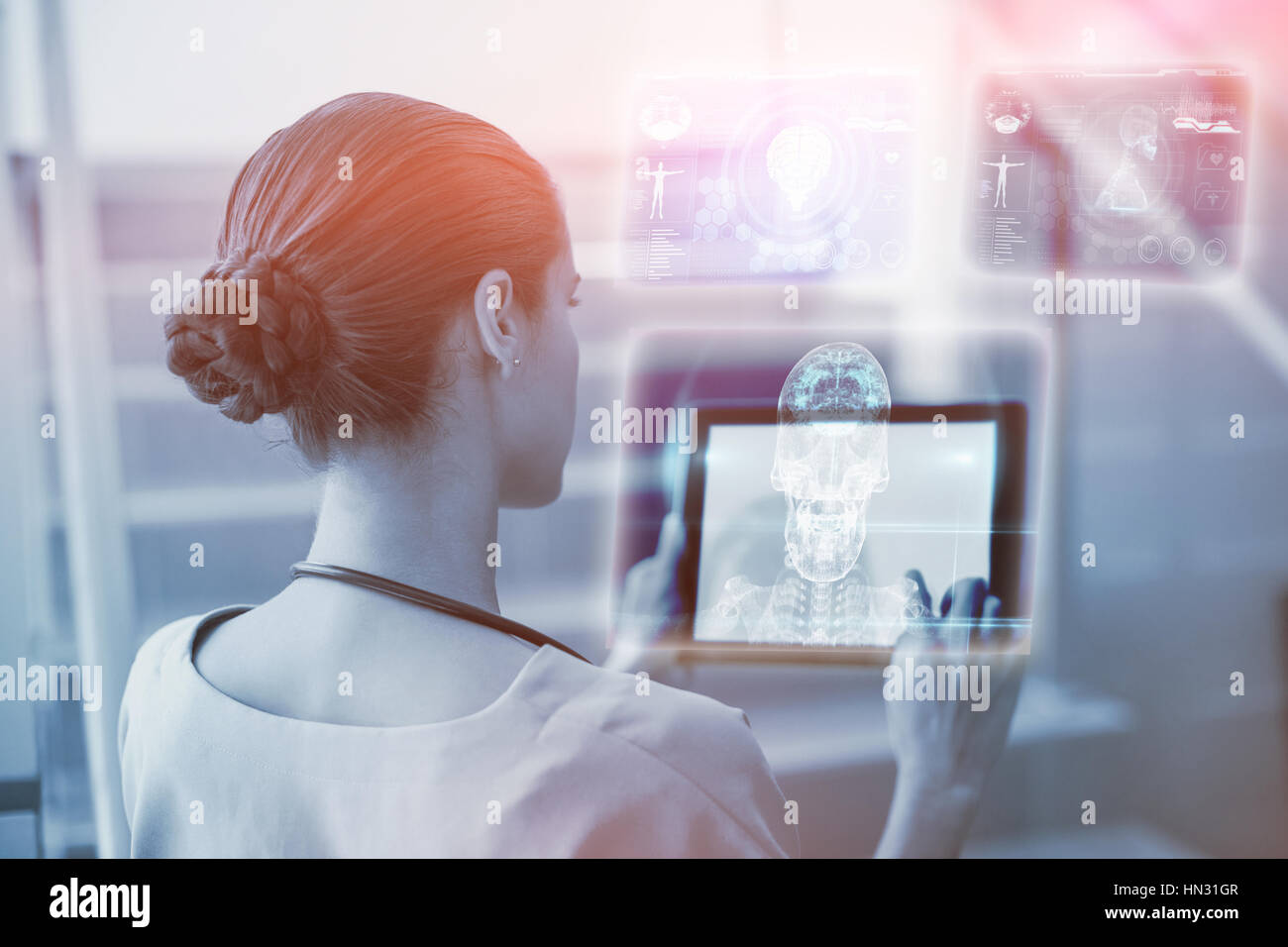 Skull and brain graphic on black against female surgeon using digital tablet 3d Stock Photo