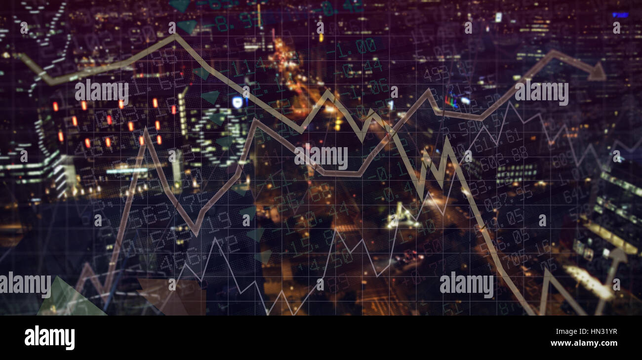 Stocks and shares against illuminated city at night - Stock Image