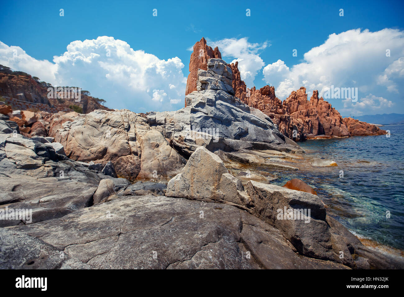 Red rocks and turquoise water of Arbatax, Sardinia - Stock Image