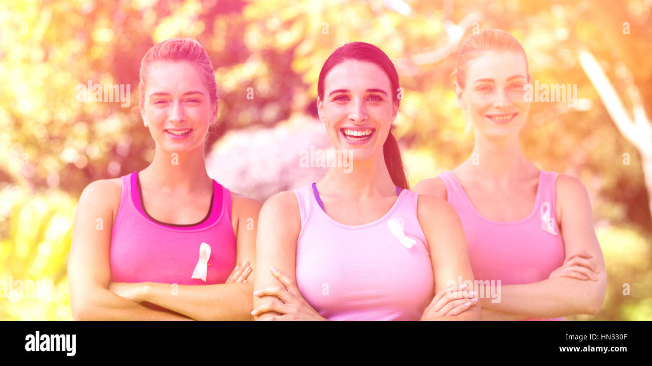 Portrait of young volunteer women smiling in park - Stock Image