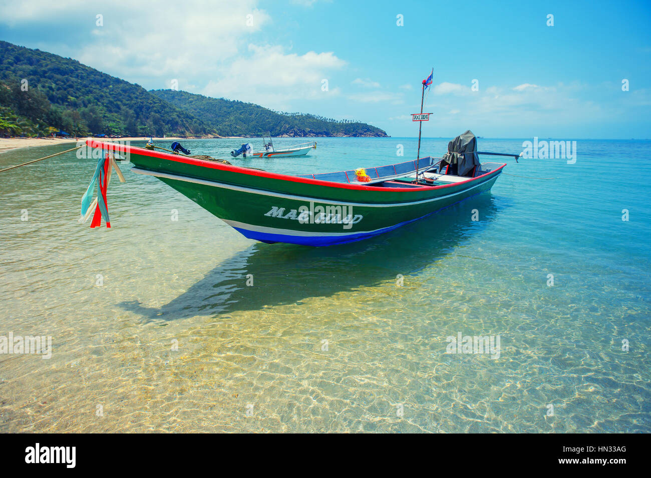 Koh Ma beach with boat at Koh Phangan Island, Thailand - Stock Image