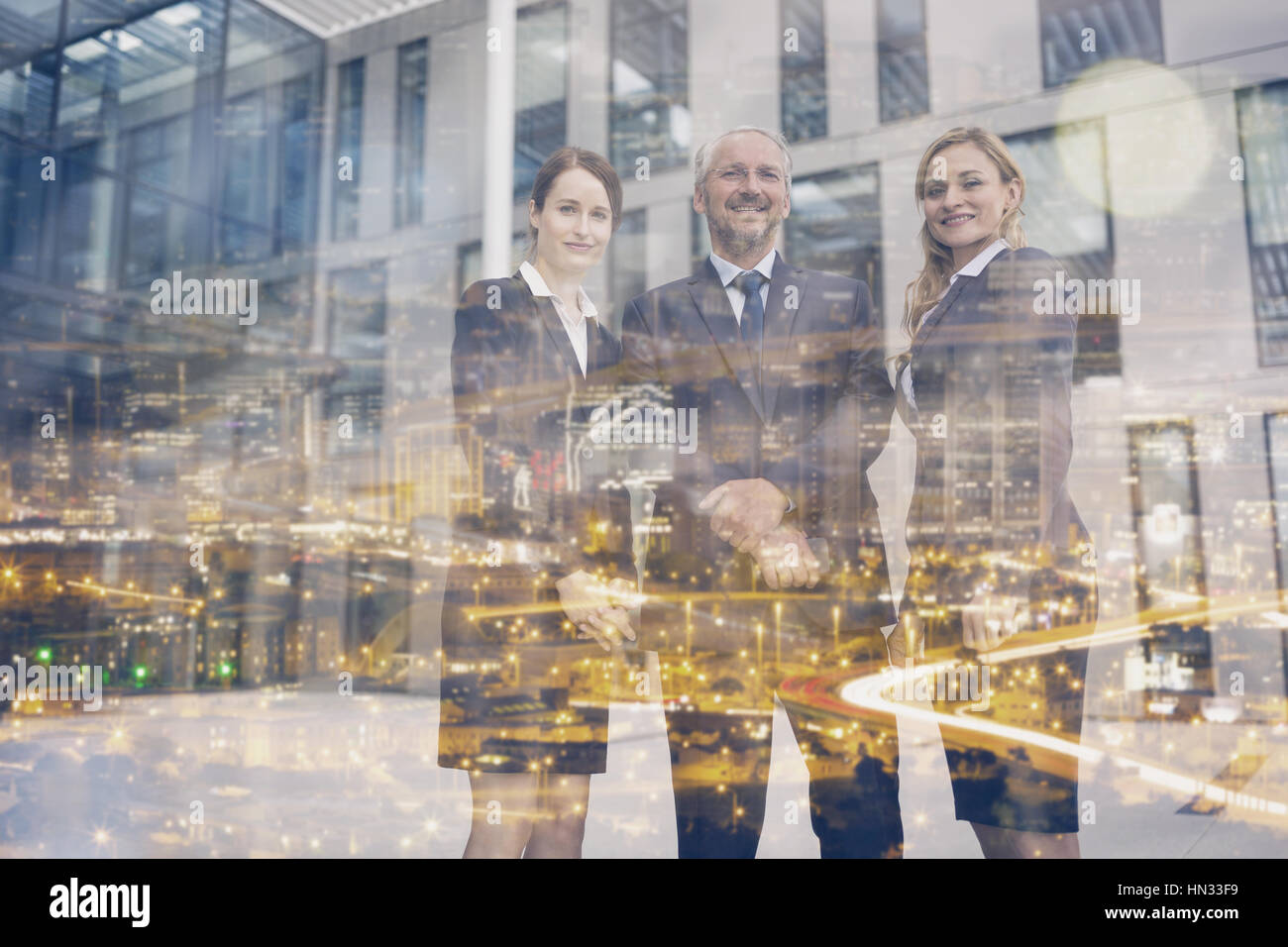 Portrait of confident businesspeople standing in office premises - Stock Image