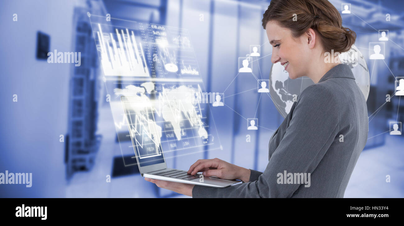 Side view of businesswoman using laptop computer against image of data storage 3d Stock Photo