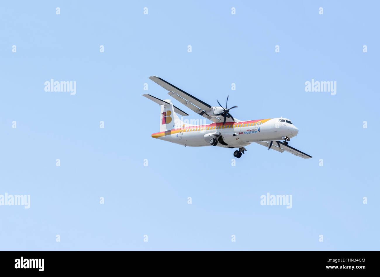 Plane ATR 72 600, of Air Nostrum airline. Iberia regional travels. Blue sky. Sunny day of spring. - Stock Image