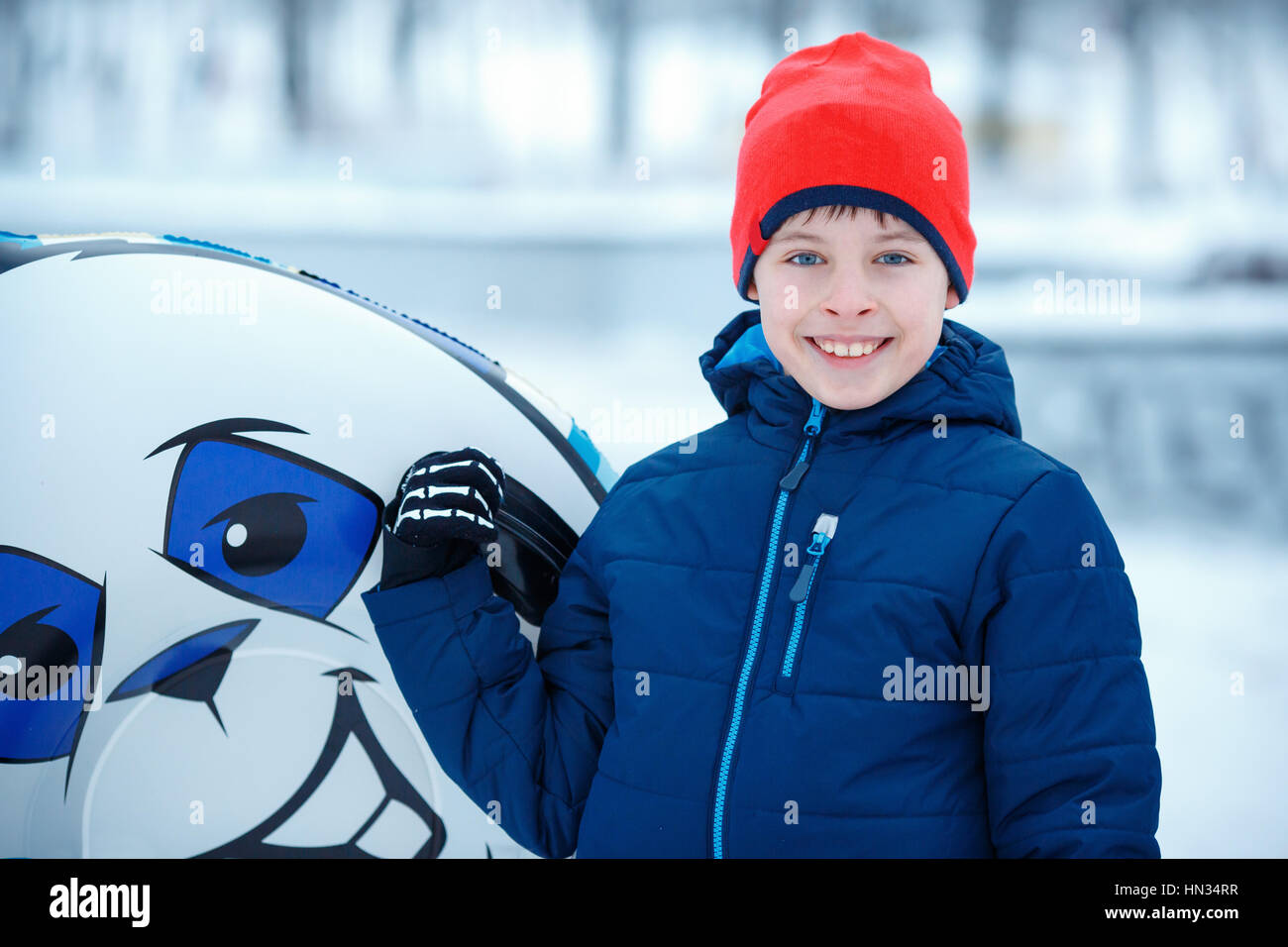 69ca3207f Cute little boy with snow tube playing outdoors Stock Photo ...