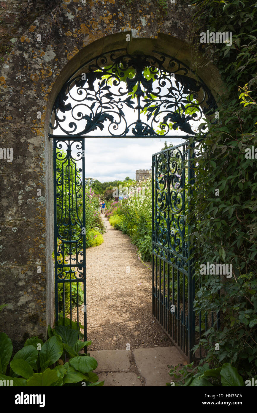 The Decorative Wrought Iron Gate And Cotswold Stone