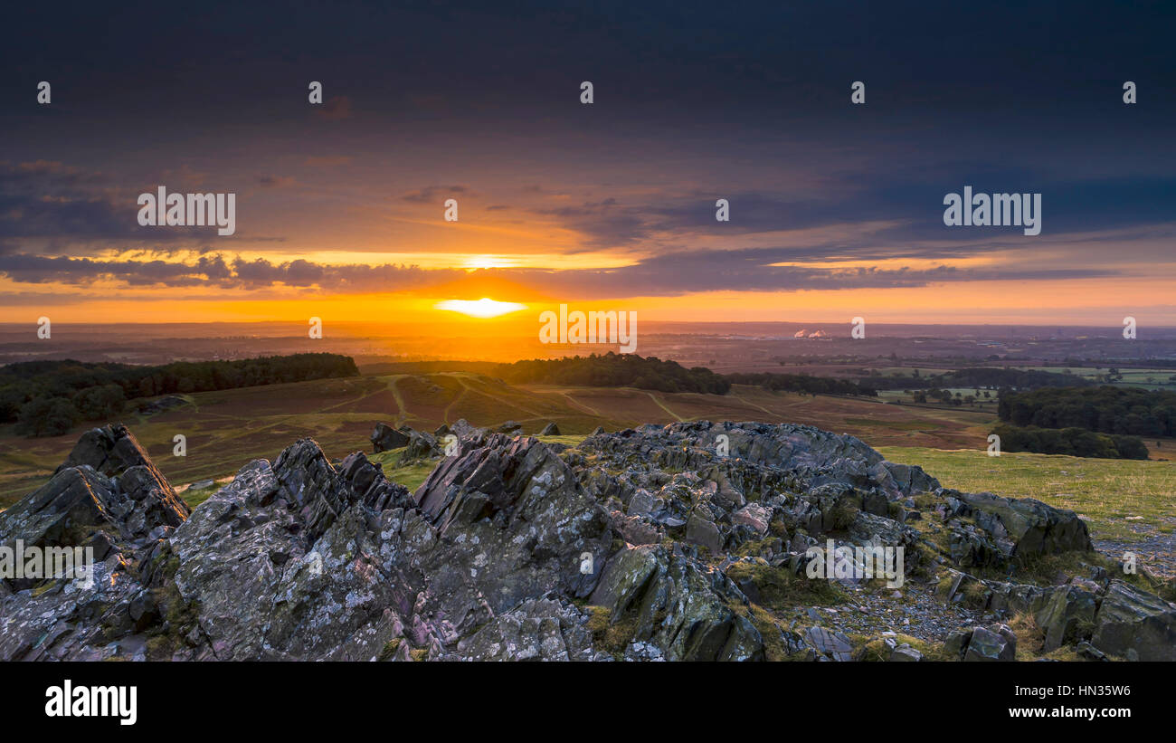 Early morning sun bounces off the Pre Cambian granite outcrops at Bradgate Park  in Leicestershire. - Stock Image