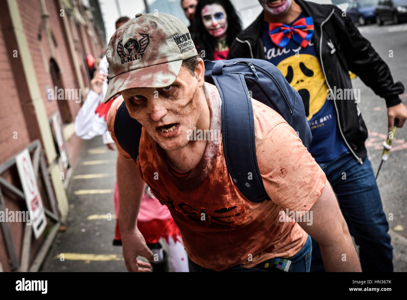 Zombies wander the streets of London in search of their undead friends in preparation for their annual World Zombie - Stock Image