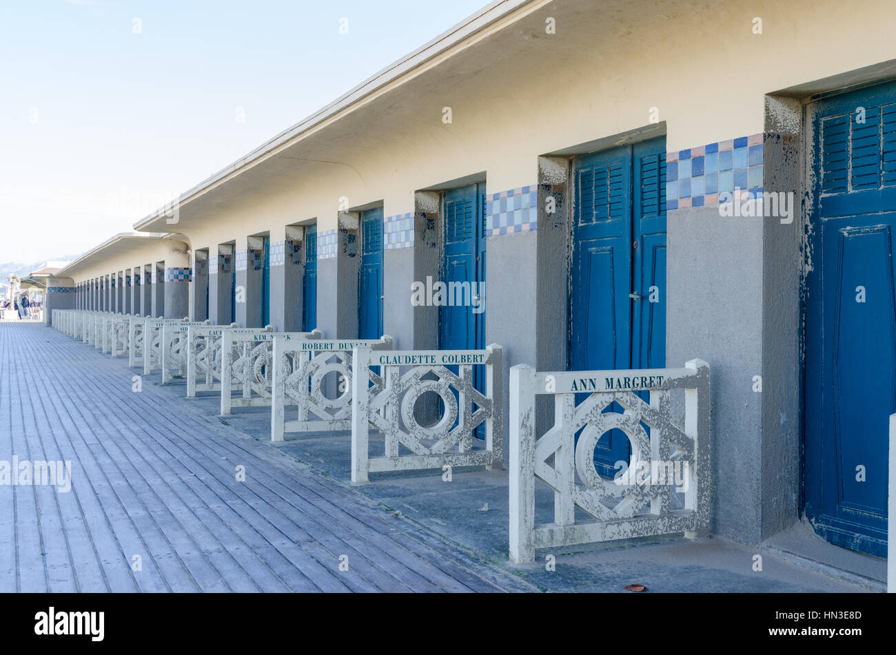 Bathing cabins along Les Planches boardwalk by the beach in the chic french seaside resort of Deauville - Stock Image