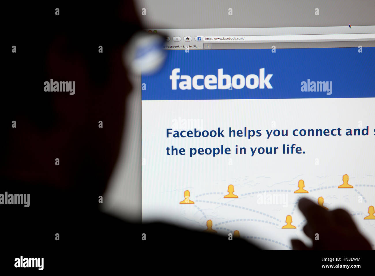 Bath, United Kingdom - May 4, 2011: Close-up of the Facebook homepage displayed on a LCD computer screen with silhouette - Stock Image