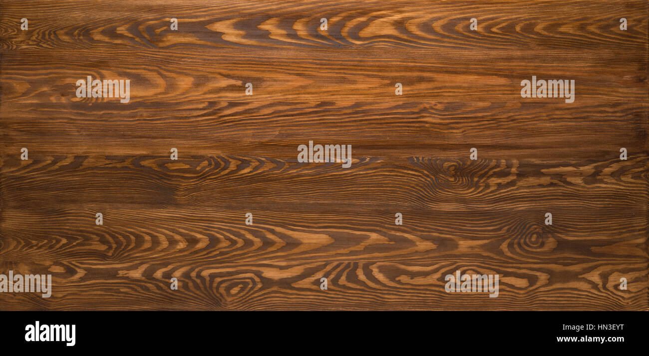 Wooden table texture, dark brown wood background - Stock Image