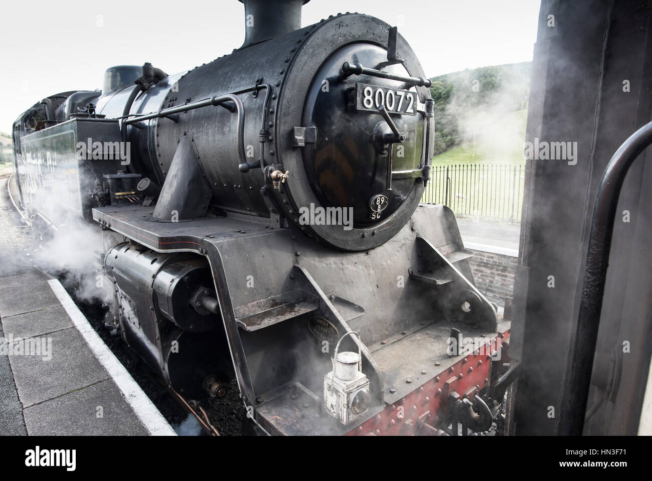 Steam engine 80072 coupling to carriage at Carrog, Denbighshire - Stock Image
