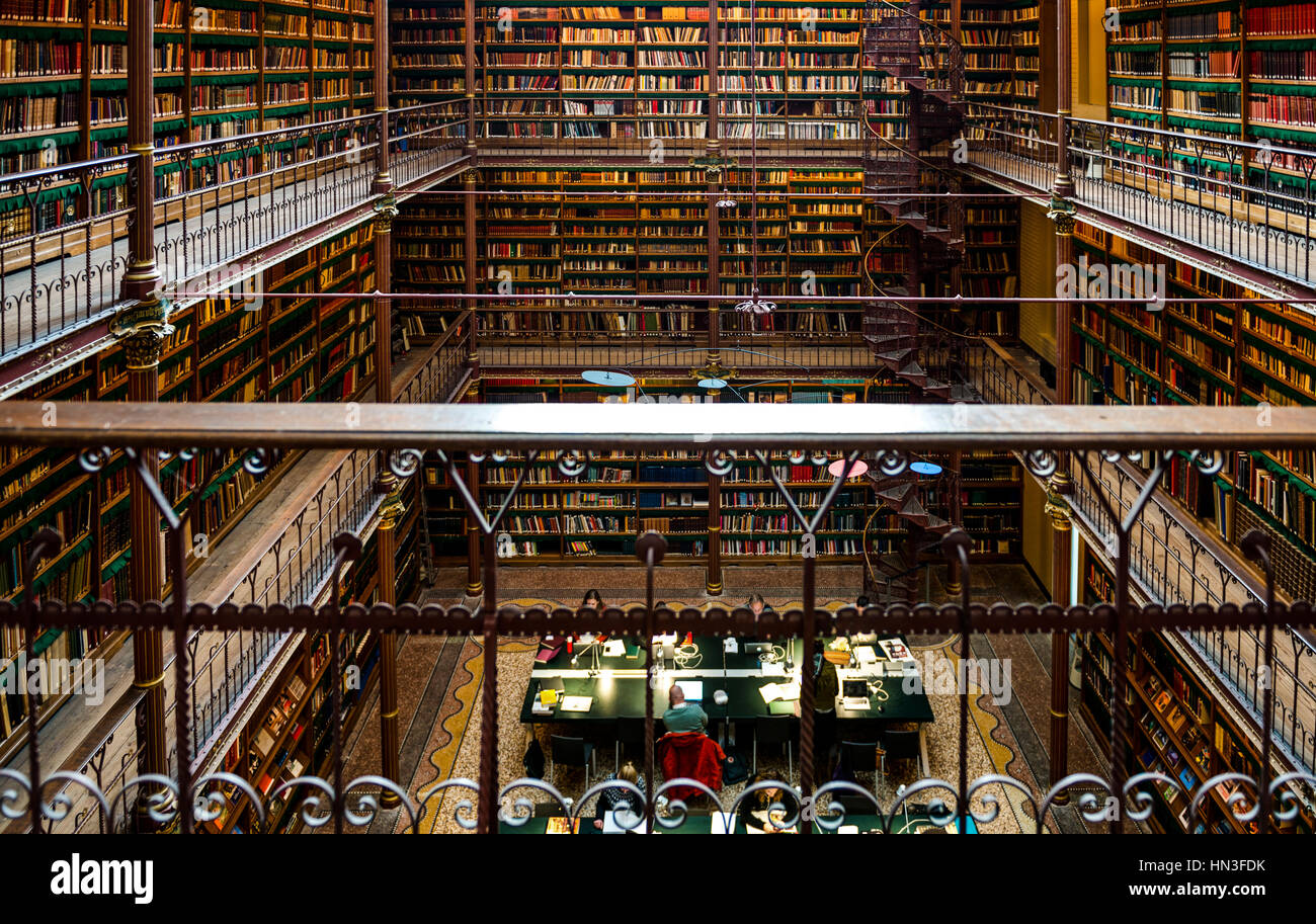 Interior Of Large Public Library With Walls Of Books And Spiral