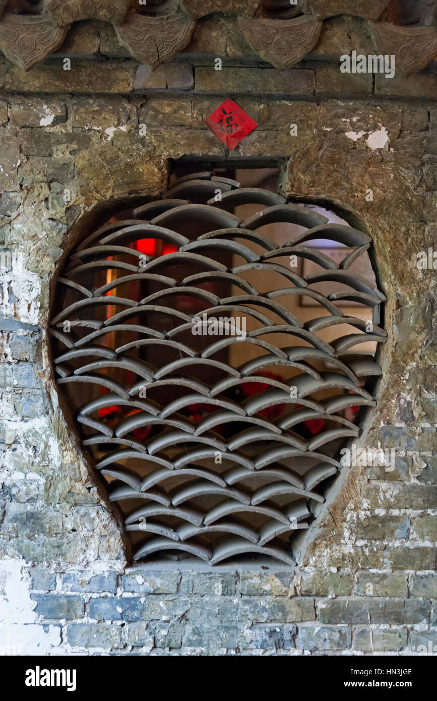 Wine jar shaped window of a renovated old days wine house, Taierzhuang Ancient Town, Shandong Province, China - Stock Image