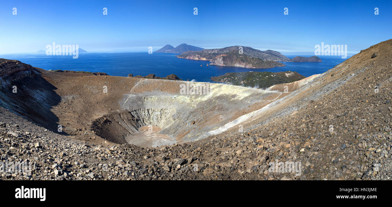 Volcano Island, Aeolian archipelago. Crater and the Mediterranean Sea in the background, vulcan with sulfur haze. - Stock Image