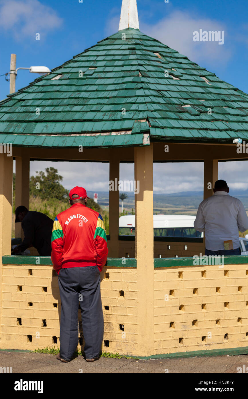 Rear view of man wearing red tracksuit top with the word 'Mauritius' on back, Mauritius, Africa - Stock Image