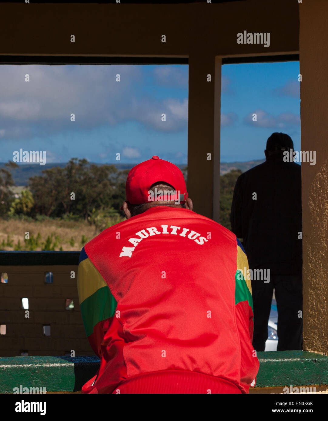 Close up rear view of man wearing red tracksuit top with the word 'Mauritius' on back, Mauritius, Africa - Stock Image