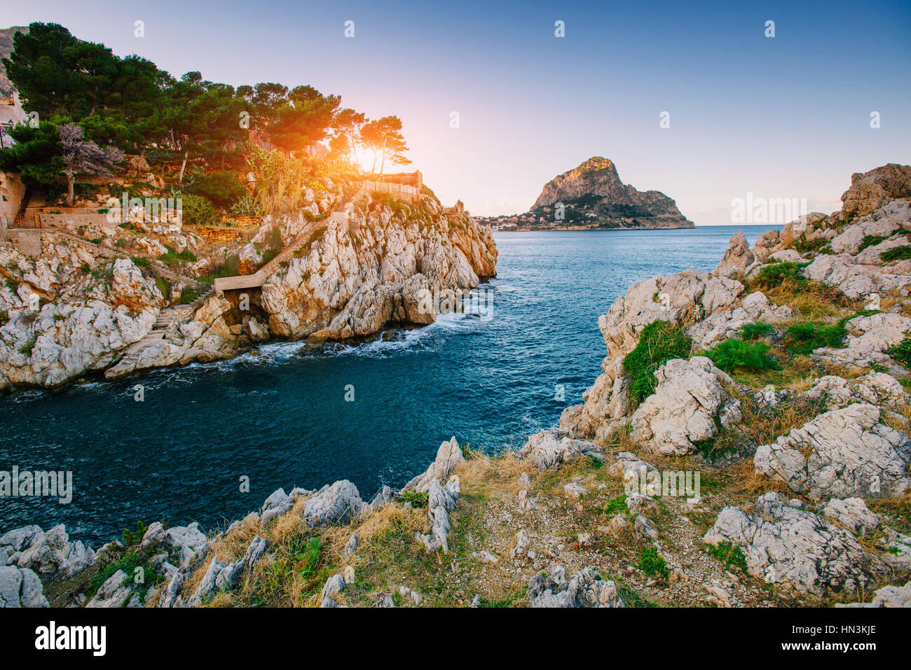 Sunset over the sea with rocks - Stock Image